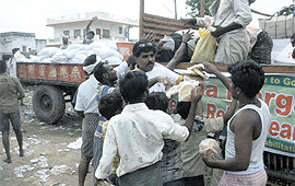 AMURT volunteers in India offload relief supplies during recent operation in Andhara Pradesh